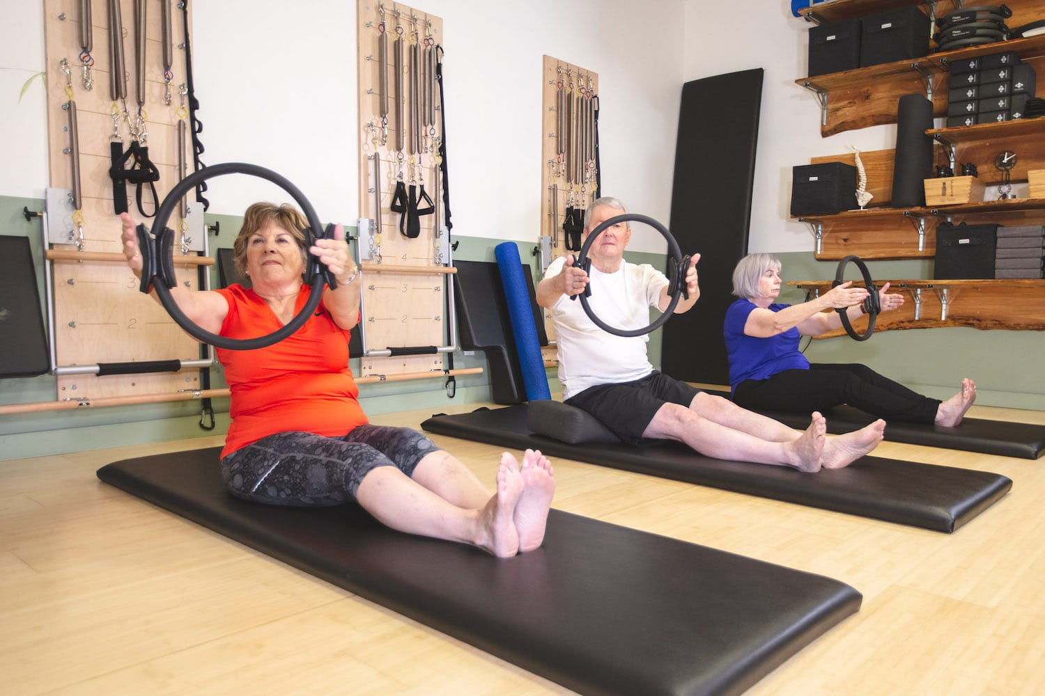 Retiree students in the studio doing an exercise